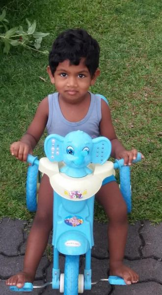 Avisha-on-tricycle