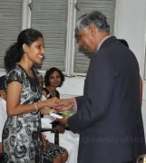 Prof Lucas giving autobiography to current student Guvanthi Abeysinghe